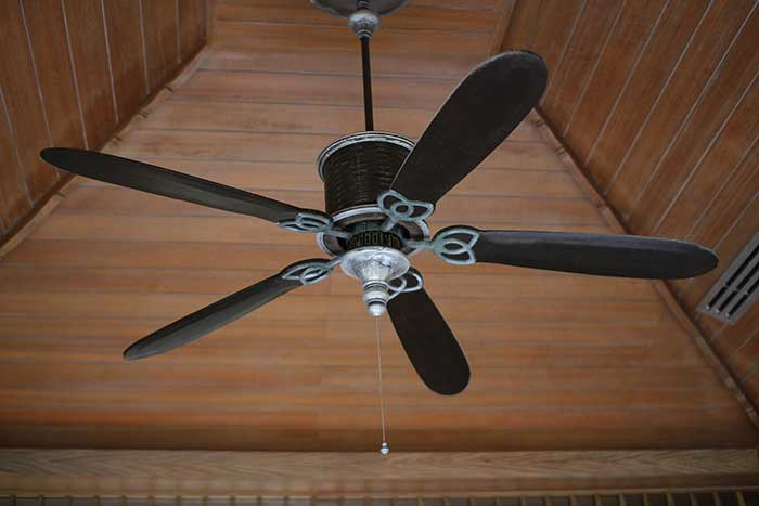 Use a ceiling fan to circulate cold air and pull hot air away during the summer nights