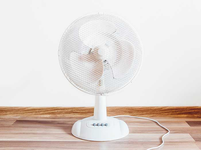 Use a desk fan to blow hot air out of your windows during the sleepless summer nights