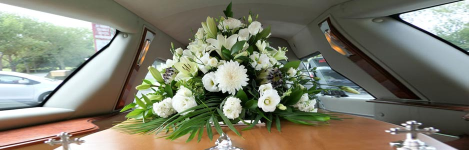 An example of funeral flowers on a coffin, as part of the funeral directors guide on Thomson Local