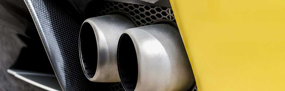 A close up photograph of a car exhaust on a high performance car