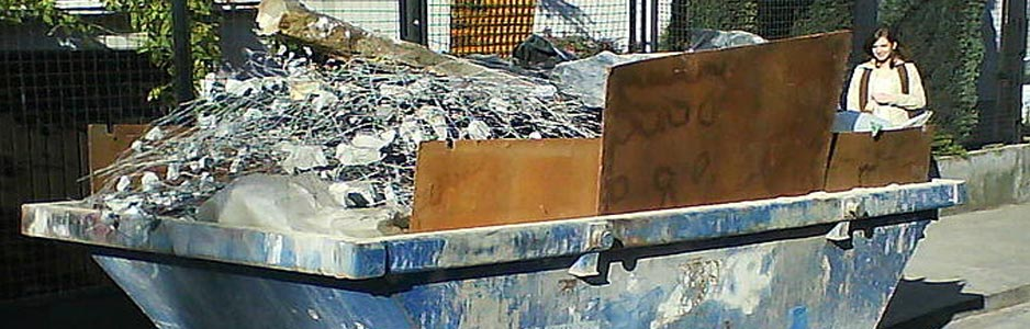 An example of a hired skip filled with waste building materials