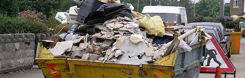 An example of a hired skip filled with rubbish outside on a street