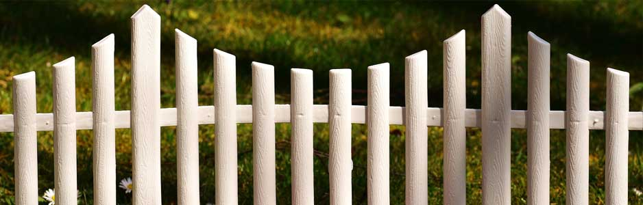 An example of a white picket garden fence