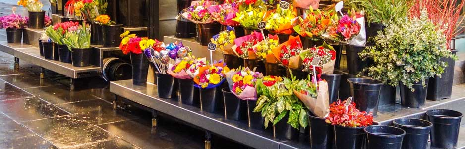 An example of a florists stand on the street with an assortment of flowers available